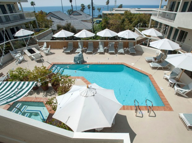 The pool is at the center of the Laguna Beach House in Laguna Beach. ADDITIONAL INFO:01.TinyHotels.05xx.mg - 05/11/2016 - MANDATORY CREDIT: MICHAEL GOULDING, ORANGE COUNTY REGISTER Laguna Beach may be known for its luxurious resorts, but there are also a handful of under 50 room boutique hotels. While not a bargain, they are cheaper than resorts and offer something different.