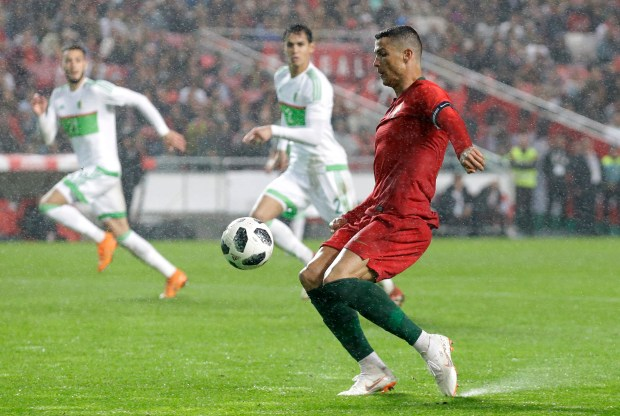 Portugal's Cristiano Ronaldo attempts a shot at goal during a friendly soccer match between Portugal and Algeria in Lisbon, Portugal, Thursday, June 7, 2018. (AP Photo/Armando Franca)