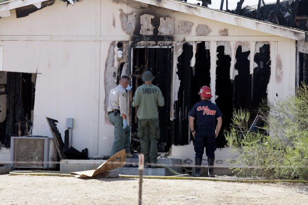 Arson and homicide investigators examine the remains of the Renee Jennex Small Family Home near Temecula after it burned on Aug. 29, 2016. (Frank Bellino, The Press-Enterprise/SCNG)