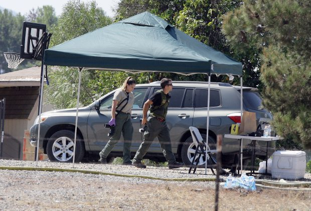 Investigators work the scene where five people were found dead inside the burned Renee Jennex Small Family Home near Temecula on Aug. 29, 2016. (Frank Bellino, The Press-Enterprise/SCNG)