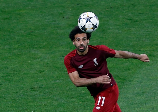 Liverpool's Mohamed Salah plays the ball during the warm up for the Champions League Final soccer match between Real Madrid and Liverpool at the Olimpiyskiy Stadium in Kiev, Ukraine, Saturday, May 26, 2018. (AP Photo/Darko Vojinovic)