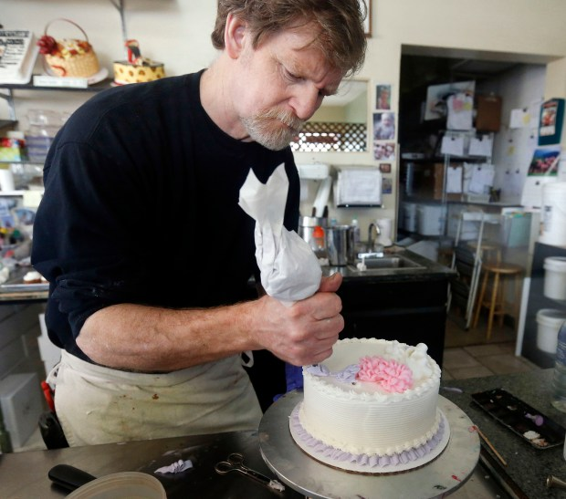 In this March 10, 2014, file photo, Masterpiece Cakeshop owner Jack Phillips decorates a cake inside his store in Lakewood, Colo. The Supreme Court is setting aside a Colorado court ruling against Phillips, who wouldn't make a wedding cake for a same-sex couple. But the court is not deciding the big issue in the case, whether a business can refuse to serve gay and lesbian people. (AP Photo/Brennan Linsley, File)
