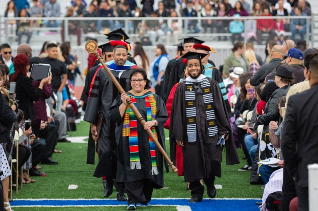 San Bernardino Valley College President Diana Rodriguez and members of the San Bernardino Community College board lead graduates during the Friday, May 25, commencement.(Photo courtesy of Luis Macedo)