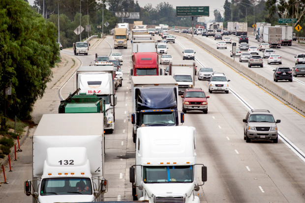 The AQMD wants to get the feds to limit tailpipe pollution from out-of-town diesel trucks like these pictured on the 605 Freeway in Whittier, Calif. June 6, 2016. (Photo by Leo Jarzomb/San Gabriel Valley Tribune)