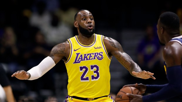 4a4c86952e8 New Los Angeles Laker LeBron James is bolstering the security at his LA  home after learning he was targeted by a team of burglars. (AP  Photo Gregory Bull)