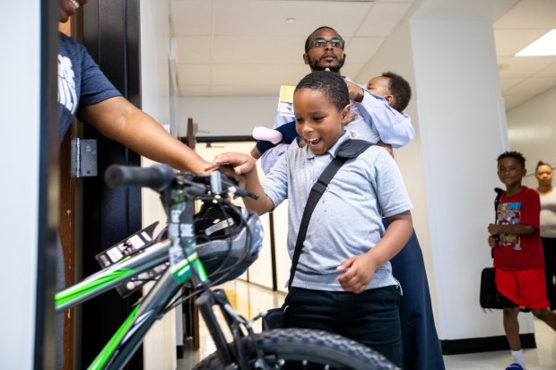 f603ea8d5c1d5 An I Promise School student receives his new bike. Every student at the  school gets a new bike. The idea s roots come from LeBron James  days as a  student