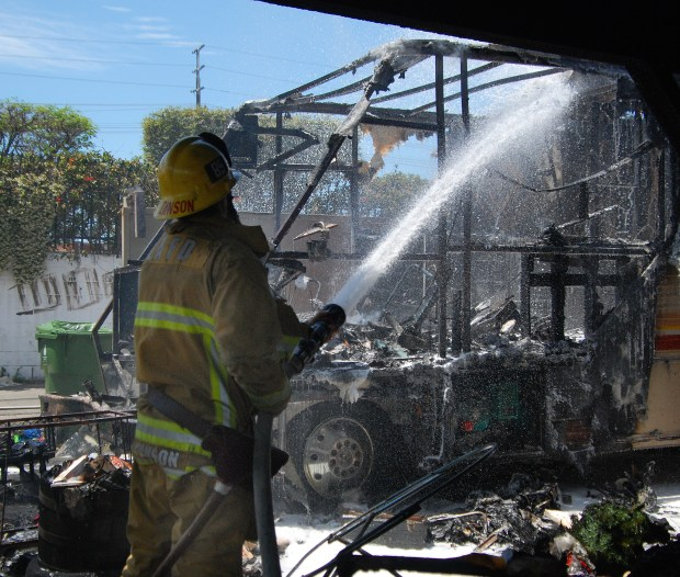 Los Angeles firefighters work on what's left of a motorhome that caught fire Friday, May 17, 2019, near San Fernando Road and Sunland Boulevard in Sunland. (Photo by Mike Meadows/Special to the Los Angeles Daily News)