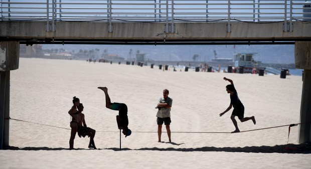 Opening weekend at L.A. County beaches busy with rescues, medical aids and lots of people
