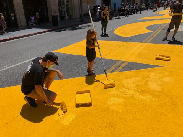 Protests unfold across LA County, volunteers paint 'All Black Lives Matter' on Hollywood Blvd.