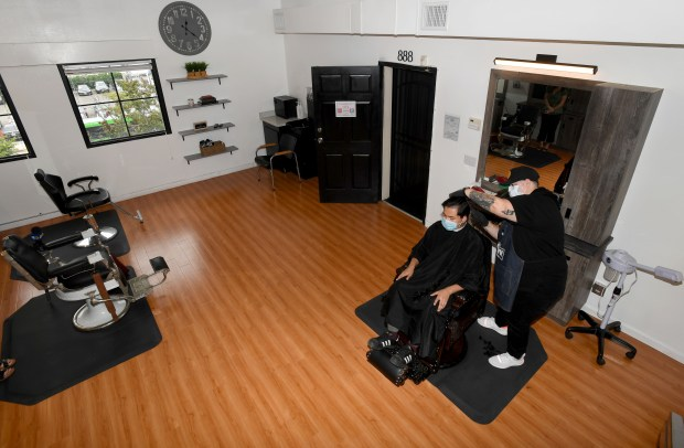 Hair salons, barbershops can reopen under updated L.A. County health order, officials say