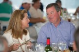 Woman and Man in conversation at a table during the 2013 Howard F. Treiber Memorial Golf Outing
