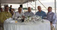 Five men seated at a table with many glasses smile at the 2013 Howard F. Treiber Memorial Golf Outing