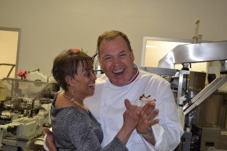 man in chef coat dancing with a woman