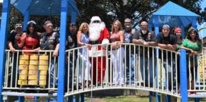 santa clause and children celebrating christmas