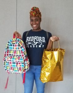 college shower distributes bags to graduating students