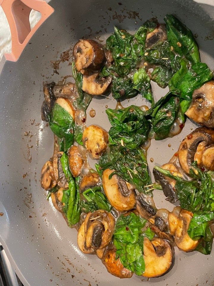the mushrooms and spinach are sautéed in herbs and spices