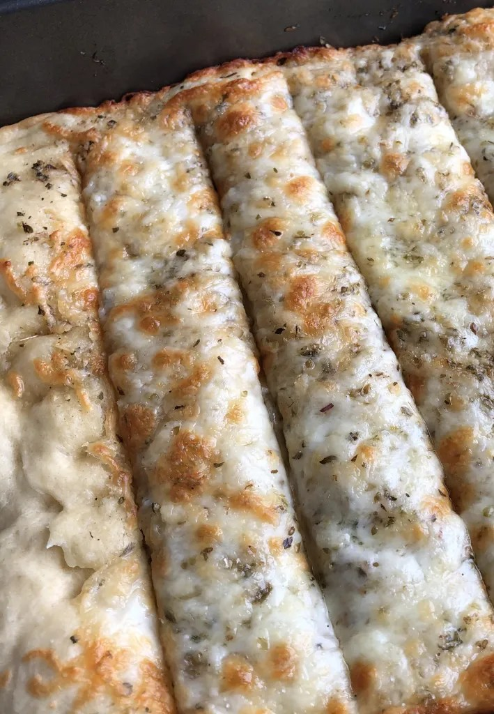 cheesy garlic breadsticks right out of the oven