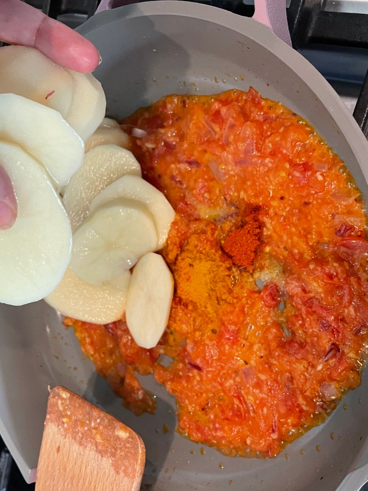 Add the soaked potatoes to the masala and spices