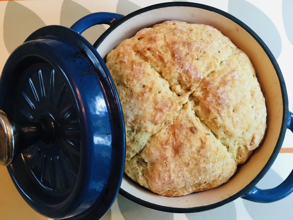 White soda bread in a casserole dish with lid on the side