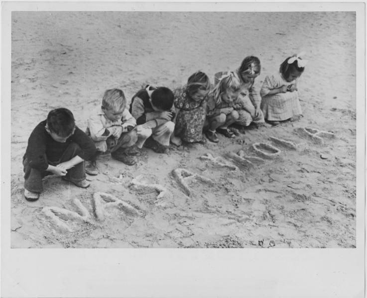 "Croatian children wrote the words for ""our school"" in the sand of the Tolumbat camp in 1945."