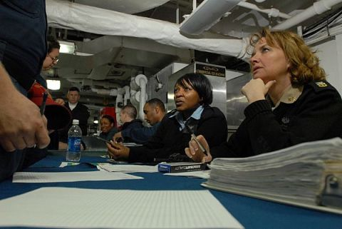Master Chief Navy Counselor Laura Paquian and Navy Counselor 1st Class Staci Bradly listen to a sailor talk about his career goals during a career development session aboard the aircraft carrier Ronald Reagan.