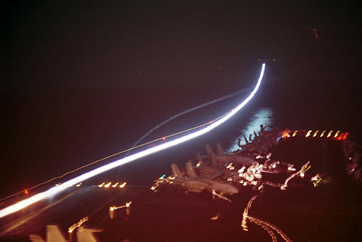 n this handout picture from the U.S. Navy made available Wednesday, Oct. 10, 2001, afterburners create streaks of light Sunday, Oct. 7, 2001, during catapult launches from the flight deck aboard USS Enterprise as Navy fighter aircraft depart for strike missions over Afghanistan. (AP Photo/U.S. Navy, Todd A. Bent)