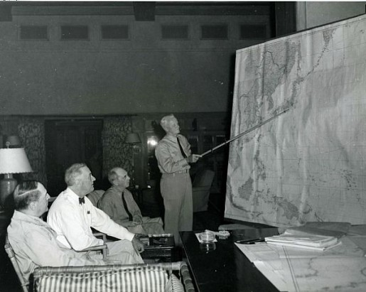 Adm. Chester Nimitz gives a presentation to an audience for the ages -- Army Gen. Douglas MacArthur, President Franklin Roosevelt and Adm. William Leahy -- in Hawaii in 1944. (Navy photo)