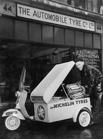 A Michelin representative delivers the goods with his Vespa scooter combination. Ideal for multiple drops of small items in urban areas (http://heritage.michelin.co.uk/p1953.htm)
