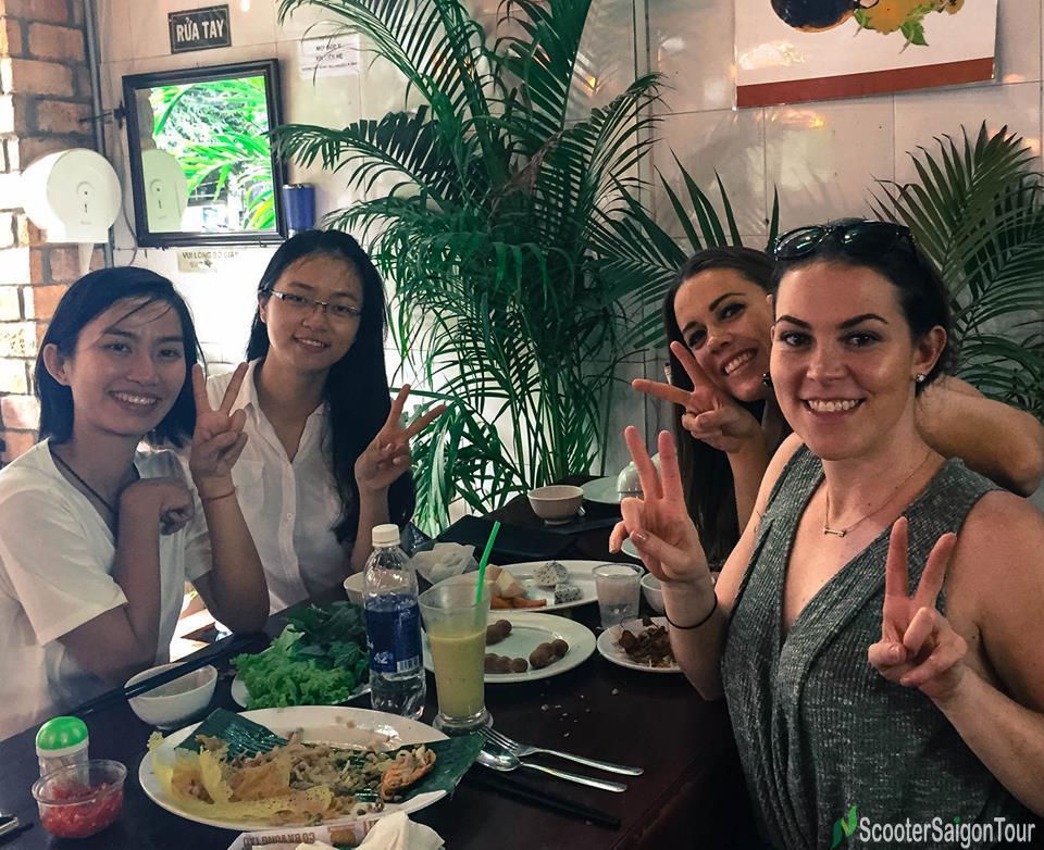 saigon food tour by motorbike eating banh xeo 2