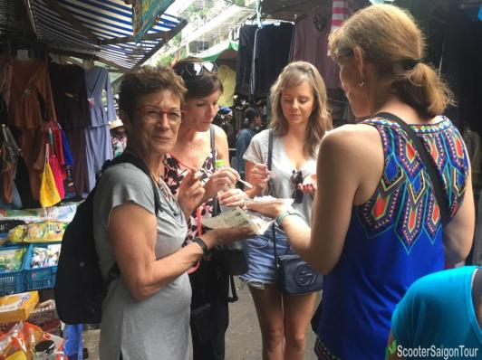 eating-steamed-sticky-rice-on-saigon-sightseeing-tour-and-street-foods-by-motorbike-tracy-do
