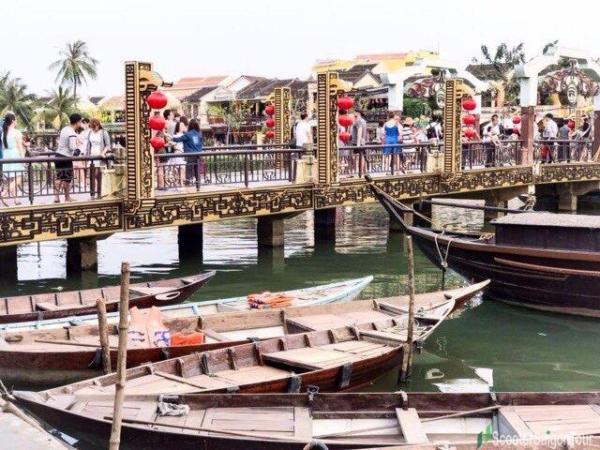 Peaceful River With Wooden Boats In Hoi An