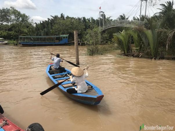 Rowing Sampan In Mekong Delta