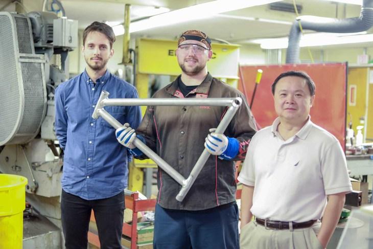 Graduate student Maximilian Sokoluk, laboratory mechanician Travis Widick, and Professor Xiaochun Li, holding a demonstration bike frame welded using aluminum alloy 7075