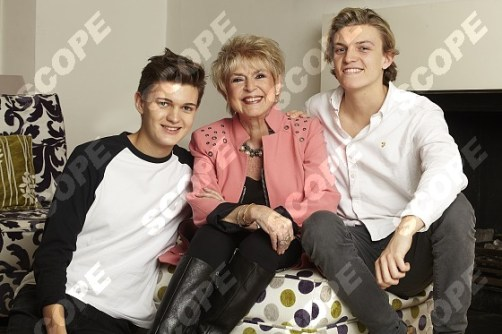 GLORIA HUNNIFORD WITH HER GRANDSONS, ( THE SONS OF CARON KEATING ) GABRIEL (Left), 17, and CHARLIE. 20, - 2014