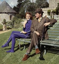 THE AVENGERS. BRITISH TV SERIES. Picture shows; Actress DIANNA RIGG as Emma Peel and actor Patrick Macnee as John Steed in an episode of The Avengers. 45013