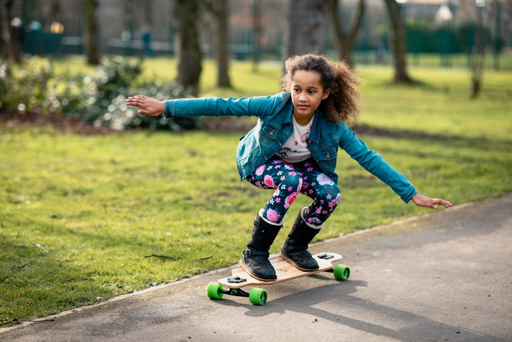 one of the 10-year-olds using a new skateboard.