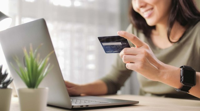 woman online shopping needs credit restoration
