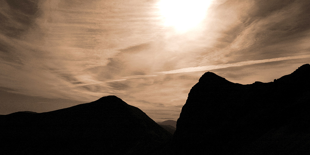Photo of Lord Reays Seat, Foinaven, silhouetted against a low autumn sun