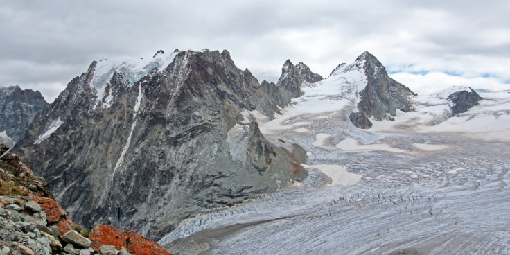 Photo of Mont Collon at the head of the Glacier d'Arolla from the Cabanes des Vignettes. L'Eveque is the pyramidal snow and rock peak to the right