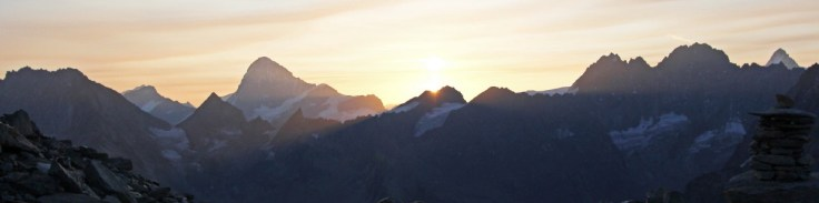 Photo of sunrise over the hills east of Arolla. The Dent Blanche centre left in the distance