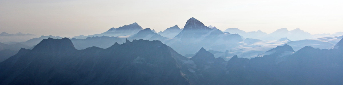 Panoramic photo from the summit of the Pigne d'Arolla. Centre left is the Weisshorn, the Grand Cornier is the next closer peak to the right joined to the dominant Dent Blanche. The Zinalrothorn is the more distant peak between the two. To the right of the Dent Blanche and to the east of Zermatt are the flat topped Alphubel, Allalinhorn, Rimpfischorn and finally Strahlhorn.