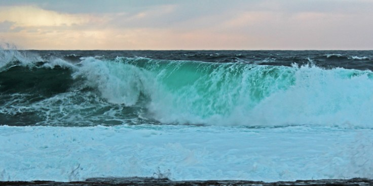 Photo of the Atlantic surging on to Caithness Flagstone rocks near Ushat Head, Crosskirk