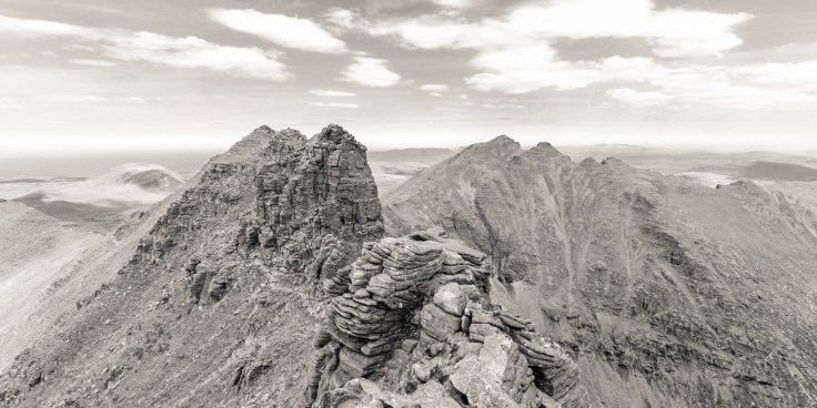 Photo of An Teallach's Corrag Bhuidhe pinnacles with Sgurr Fiona the left hand peak and Bidean a' Ghlas Thuill to the right