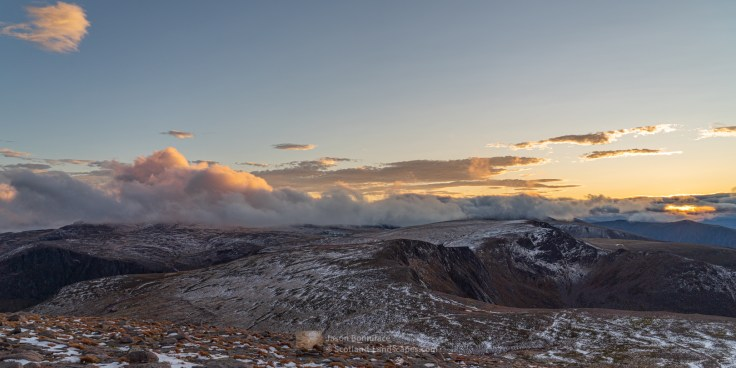 Photo south west from Cairngorm over the Northern Corries to the sun setting behind Sgoran Dubh Mor (one of the Glen Feshie hills). Ben Macdui is shrouded in cloud on the left