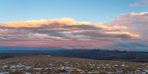 Easterly view from the summit of Cairngorm with clouds highlighted by the setting sun