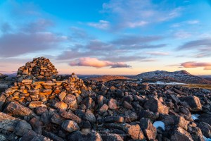 Glas Bheinn summit rocks and cairn with Ben More Assynt and Conival beyond