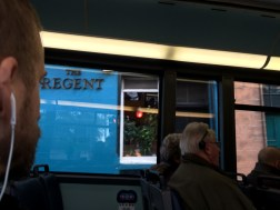 Bobby listening to the audio tour on the double decker bus.