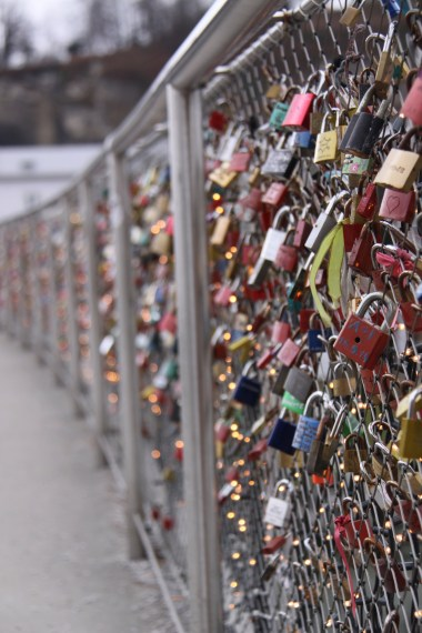 one of the gates that cross the river with love locks