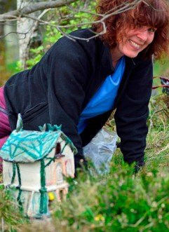 Lesley Burr with her ceramic treehouse.