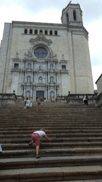 Clambering to the entrance of Girona's cathedral